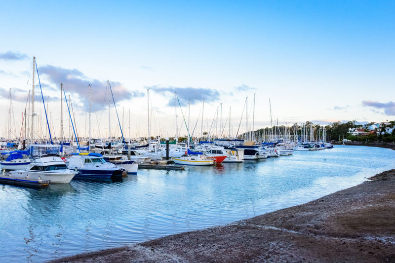 Boats in a marina with insurance